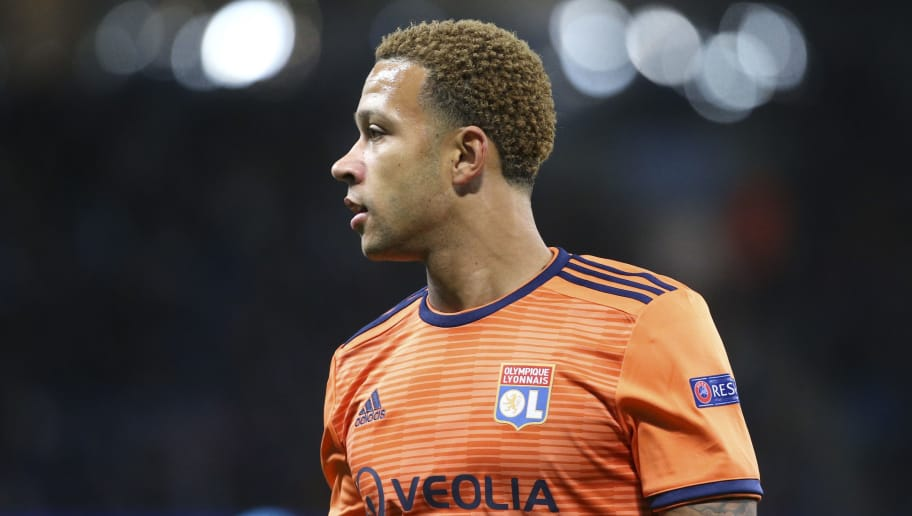 MANCHESTER, ENGLAND - SEPTEMBER 19: Memphis Depay of Lyon during the Group F match of the UEFA Champions League between Manchester City and Olympique Lyonnais (OL) at Etihad Stadium on September 19, 2018 in Manchester, United Kingdom. (Photo by Jean Catuffe/Getty Images)