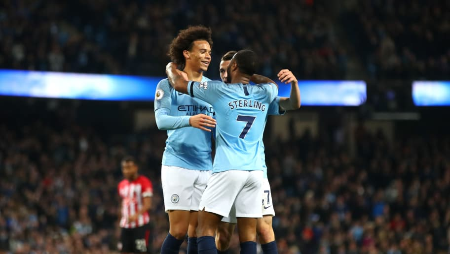 MANCHESTER, ENGLAND - NOVEMBER 04:  Leroy Sane of Manchester City celebrates with teammates Phil Foden, and Raheem Sterling after scoring his team's sixth goal during the Premier League match between Manchester City and Southampton FC at Etihad Stadium on November 4, 2018 in Manchester, United Kingdom.  (Photo by Clive Brunskill/Getty Images)