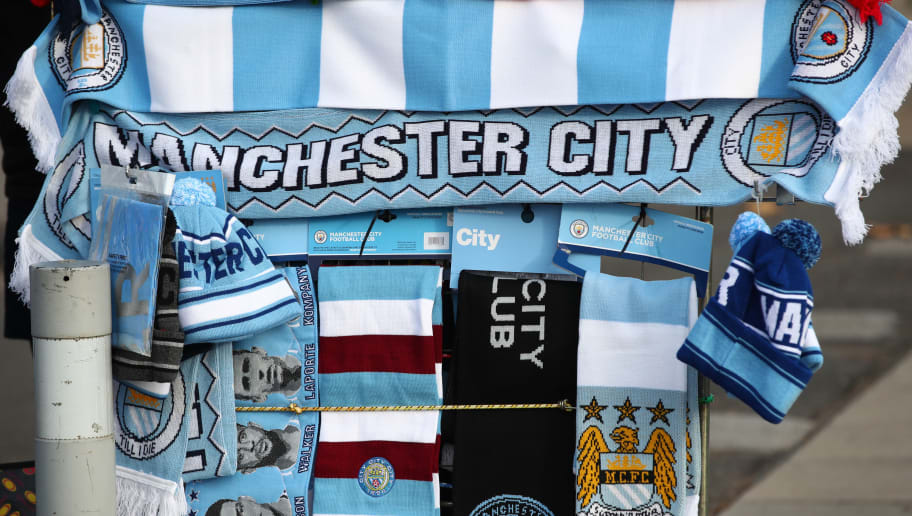 MANCHESTER, ENGLAND - NOVEMBER 04:  Merchandise is sold outside the stadium during the Premier League match between Manchester City and Southampton FC at Etihad Stadium on November 4, 2018 in Manchester, United Kingdom.  (Photo by Clive Brunskill/Getty Images)