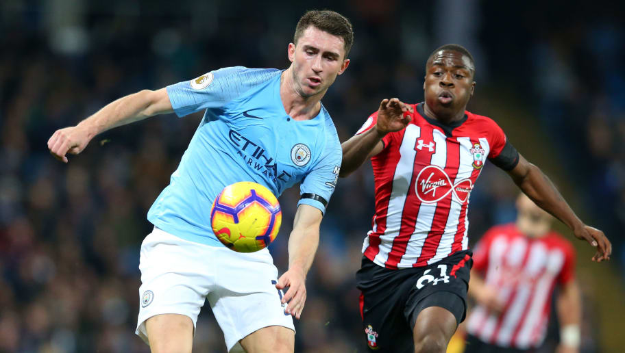 MANCHESTER, ENGLAND - NOVEMBER 04:  Aymeric Laporte of Manchester City battles for possession with Michael Obafemi of Southampton during the Premier League match between Manchester City and Southampton FC at Etihad Stadium on November 4, 2018 in Manchester, United Kingdom.  (Photo by Alex Livesey/Getty Images)