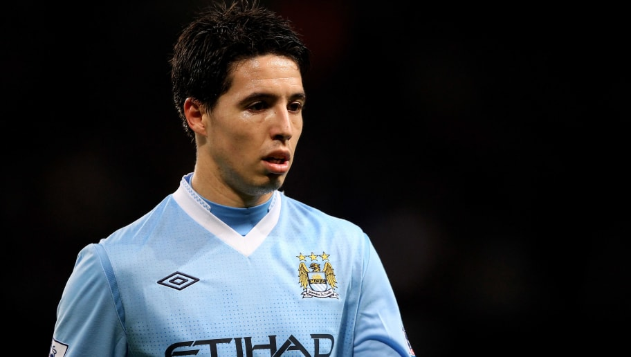 MANCHESTER, ENGLAND - DECEMBER 21:   Samir Nasri of Manchester City looks on during the Barclays Premier League match between Manchester City and Stoke City at the Etihad Stadium on December 21, 2011 in Manchester, England.  (Photo by Alex Livesey/Getty Images)