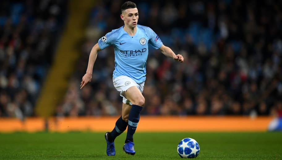 MANCHESTER, ENGLAND - DECEMBER 12: Phil Foden of Manchester City during the UEFA Champions League Group F match between Manchester City and TSG 1899 Hoffenheim at Etihad Stadium on December 12, 2018 in Manchester, United Kingdom. (Photo by Gareth Copley/Getty Images)
