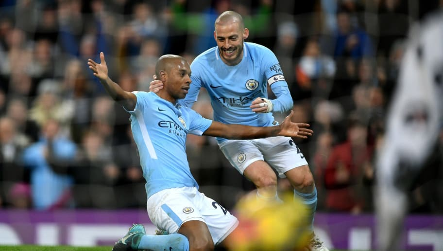 MANCHESTER, ENGLAND - JANUARY 31:  Fernandinho of Manchester City celebrates after scoring his sides first goal with David Silva of Manchester City during the Premier League match between Manchester City and West Bromwich Albion at Etihad Stadium on January 31, 2018 in Manchester, England.  (Photo by Laurence Griffiths/Getty Images)