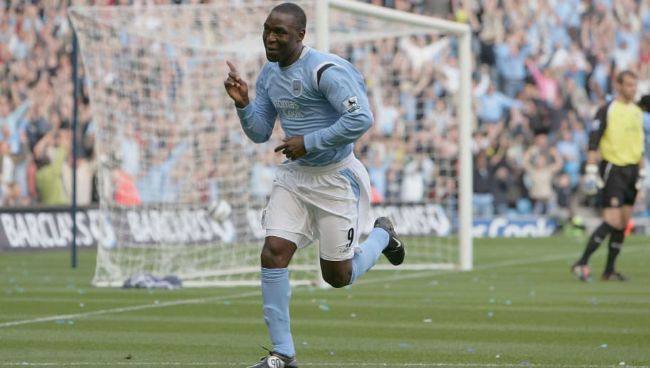 MANCHESTER, UNITED KINGDOM - OCTOBER 16:  Andy Cole of Manchester City celebrates after scoring the opening goal during the Barclays Premiership match between Manchester City and West Ham United at the City of Manchester Stadium on October 16, 2005 in Manchester, England.  (Photo by Laurence Griffiths/Getty Images)