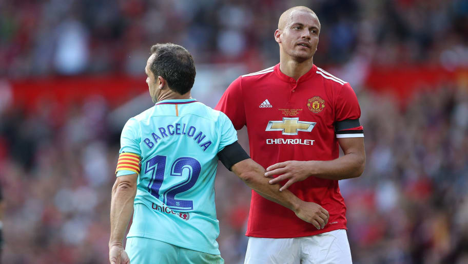 MANCHESTER, ENGLAND - SEPTEMBER 02: Sergi of FC Barcelona Legends and Wes Brown of Manchester United Legends at full time  during the match between Manchester United Legends and  FC Barcelona Legends at Old Trafford on September 2, 2017 in Manchester, England. (Photo by Robbie Jay Barratt - AMA/Getty Images)
