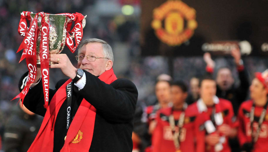 Manchester United manager Sir Alex Ferguson celebrates with the trophy after his team beat Aston Villa 2-1 to win the 2010 Carling Cup Final at Wembley, in north London, on February 28, 2010. AFP PHOTO/CARL DE SOUZA (Photo credit should read CARL DE SOUZA/AFP/Getty Images)