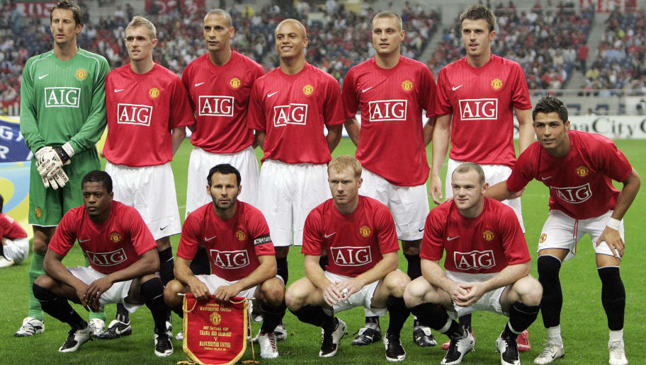 Manchester United players pose prior to...