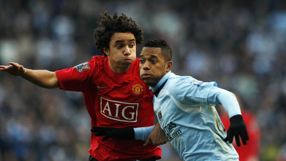 Manchester United's Brazilian defender Rafael Da Silva (L) and Manchester City's Brazilian forward Robinho compete for the ball during their English Premier League football match at The City of Manchester Stadium in Manchester, north west England on November 30, 2008. AFP PHOTO/PAUL ELLIS - FOR EDITORIAL USE ONLY Additional licence required for any commercial/promotional use or use on TV or internet (except identical online version of newspaper) of Premier League/Football League photos. Tel DataCo +44 207 2981656. Do not alter/modify photo. (Photo credit should read PAUL ELLIS/AFP/Getty Images)
