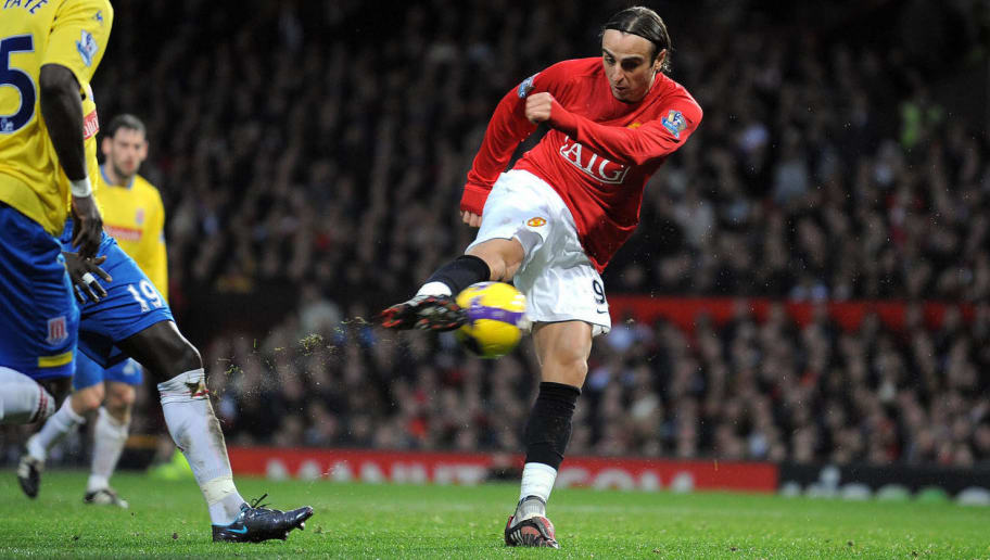 Manchester United's Bulgarian forward Dimitar Berbatov (R) scores the third goal during the English Premiership football match against Stoke City at Old Trafford, Manchester, north-west England, on November 15 2008. AFP PHOTO/ANDREW YATES.  FOR EDITORIAL USE ONLY Additional licence required for any commercial/promotional use or use on TV or internet (except identical online version of newspaper) of Premier League/Football League photos. Tel DataCo +44 207 2981656. Do not alter/modify photo. (Photo credit should read ANDREW YATES/AFP/Getty Images)