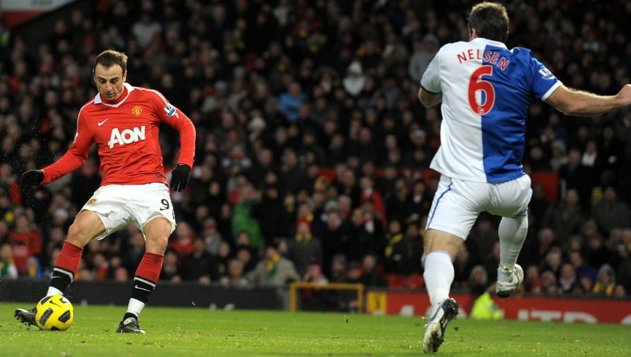 Manchester United's Bulgarian striker Dimitar Berbatov (L) scores his third goal past Blackburn's New Zealand defender Ryan Nelsen (R) during the English Premier League football match between Manchester United and Blackburn Rovers at Old Trafford in Manchester, north-west England on November 27, 2010. Manchester United won the game 7-1. AFP PHOTO/ANDREW YATES  FOR  EDITORIAL USE Additional licence required for any commercial/promotional use or use on TV or internet (except identical online version of newspaper) of Premier League/Football League photos. Tel DataCo +44 207 2981656. Do not alter/modify photo (Photo credit should read ANDREW YATES/AFP/Getty Images)