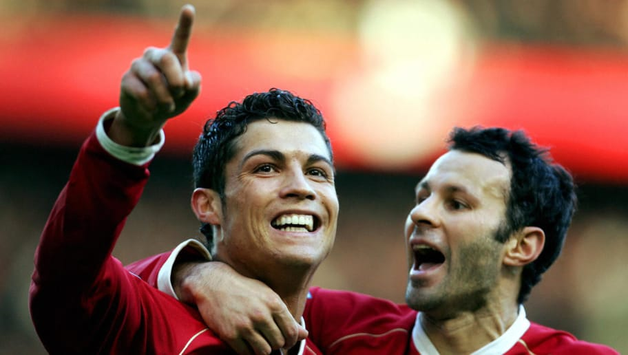 Manchester, UNITED KINGDOM:  Manchester United's Cristiano Ronaldo (L) celebrates with Ryan Giggs after scoring against Manchester City during their English Premiership football match at Old Trafford, in Manchester, 09 December 2006. AFP PHOTO/PAUL ELLIS Mobile and website use of domestic English football pictures subject to subscription of a license with Football Association Premier League (FAPL) tel : +44 207 298 1656. For newspapers where the football content of the printed and electronic versions are identical, no licence is necessary.  (Photo credit should read PAUL ELLIS/AFP/Getty Images)