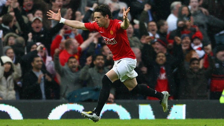 Manchester United's English midfielder Owen Hargreaves celebrates scoring against Arsenal during their English Premier League football match at Old Trafford in Manchester, north west England on April 13, 2008. AFP PHOTO/PAUL ELLIS - Mobile and website use of domestic English football pictures are subject to obtaining a Photographic End User Licence from Football DataCo Ltd Tel : +44 (0) 207 864 9121 or e-mail accreditations@football-dataco.com - applies to Premier and Football League matches. (Photo credit should read PAUL ELLIS/AFP/Getty Images)