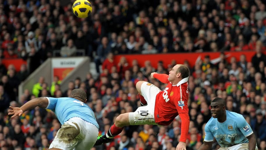 Manchester United's English striker Wayne Rooney (2nd L) scores their second goal between Manchester City's Belgian midfielder Vincent Kompany (L) and English defender Micah Richards (R) during the English Premier League football match between Manchester United and Manchester City at Old Trafford in Manchester, north-west England on February 12, 2011. AFP PHOTO/ANDREW YATESRESTRICTED TO EDITORIAL USE Additional licence required for any commercial/promotional use or use on TV or internet (except identical online version of newspaper) of Premier League/Football League photos. Tel DataCo +44 207 2981656. Do not alter/modify photo (Photo credit should read ANDREW YATES/AFP/Getty Images)