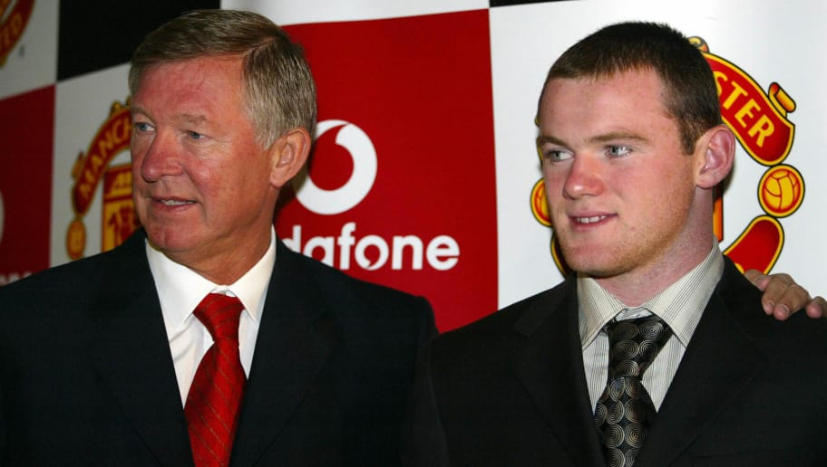 MANCHESTER, UNITED KINGDOM:  Manchester United's new signing Wayne Rooney (R) with manager Alex Furguson (L), 01 September 2004, seen at today's press conference after his signing at Old Trafford, Manchester, United Kingdom.  AFP PHOTO      Paul Barker     (Photo credit should read PAUL BARKER/AFP/Getty Images)