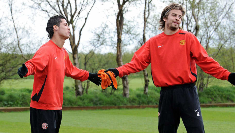Manchester United's Portugese midfielder Cristiano Ronaldo (L) and Spanish defender Gerard Piqu? react during a team training session at the Carrington training complex in Manchester, north-west England, on April 28, 2008. Manchester United challenge Barcelona in the second leg of a UEFA Champions League semi-final game at Old Trafford on Tuesday April 29. AFP PHOTO/ANDREW YATES   (Photo credit should read ANDREW YATES/AFP/Getty Images)
