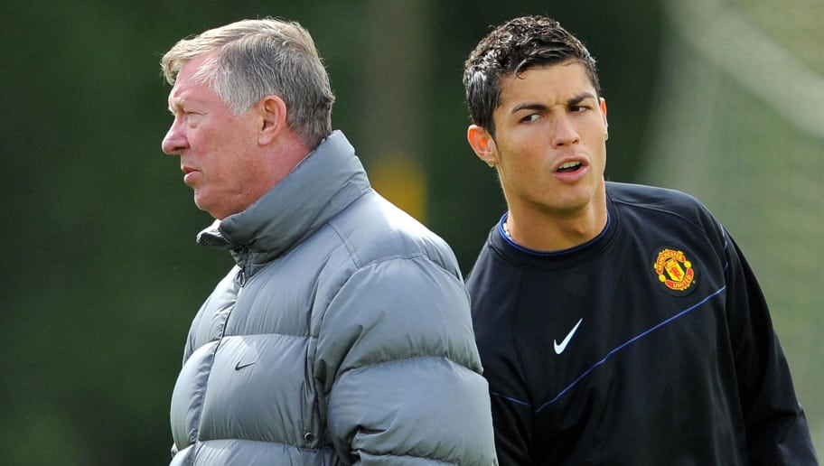 Manchester United's Portuguese midfielder Cristiano Ronaldo (R) is pictured with Manchester United manager Alex Ferguson during a training session at the Carrington training complex, in Manchester, north west England, on May 20, 2009, in preparation for next weeks UEFA Champions league final against Barcelona in Rome. AFP PHOTO/ANDREW YATES   (Photo credit should read ANDREW YATES/AFP/Getty Images)