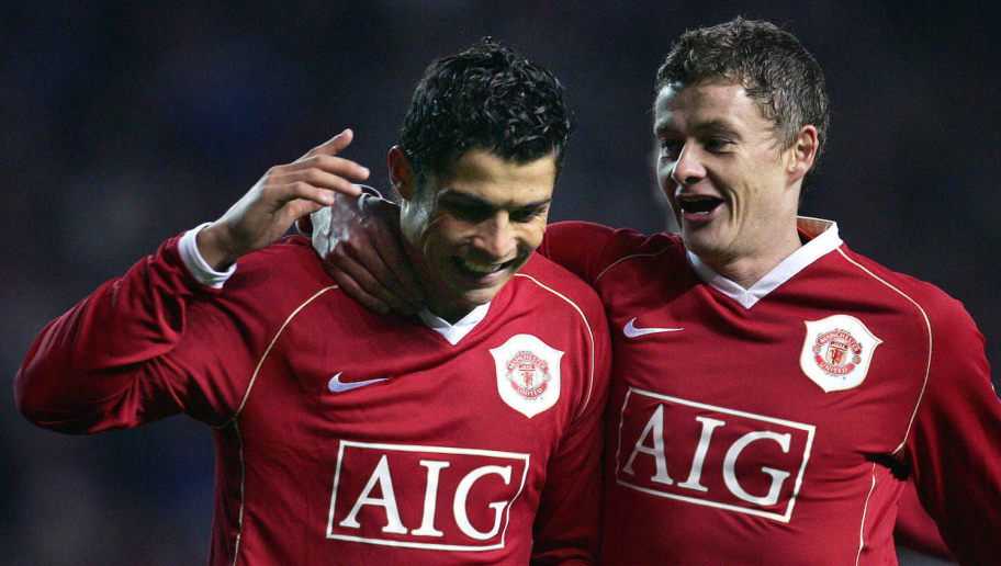 Manchester, UNITED KINGDOM:  Manchester United's Portuguese striker Cristiano Ronaldo celebrates with Ole Gunnar Solskjaer after scoring a rebounded penalty against Wigan Athletic during their English Premiership football match at Old Trafford in Manchester, 26 December 2006. AFP PHOTO / PAUL ELLIS Mobile and website use of domestic English football pictures subject to subscription of a license with Football Association Premier League (FAPL) tel : +44 207 298 1656. For newspapers where the football content of the printed and electronic versions are identical, no licence is necessary.  (Photo credit should read PAUL ELLIS/AFP/Getty Images)