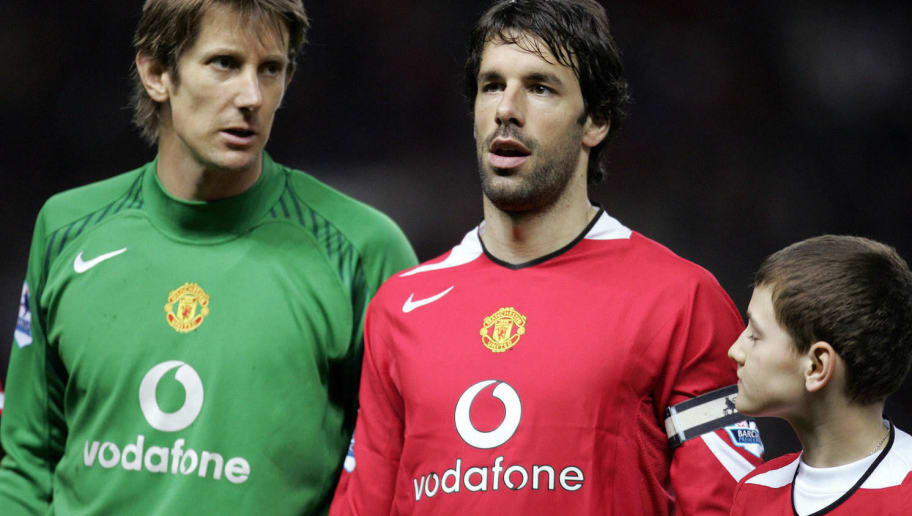 Manchester, UNITED KINGDOM:  Manchester United's Ruud van Nistelrooy (C) captains the team in the absence of Gary Neville for the match against West Ham United in their English Premiership soccer match at Old Trafford, Manchester 29 March 2006. AFP PHOTO/PAUL ELLIS Mobile and website use of domestic English football pictures subject to subscription of a license with Football Association Premier League (FAPL) tel : +44 207 298 1656. For newspapers where the football content of the printed and electronic versions are identical, no licence is necessary.  (Photo credit should read PAUL ELLIS/AFP/Getty Images)
