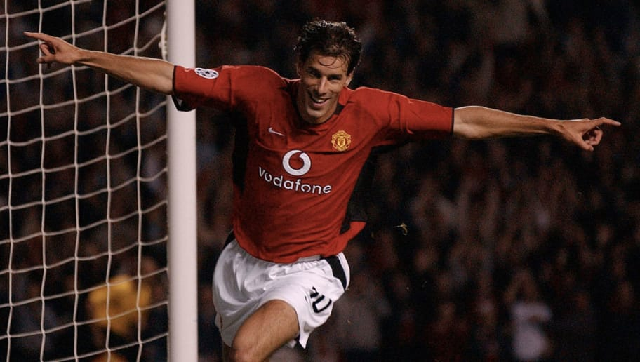 MANCHESTER, UNITED KINGDOM:  Manchester United's Ruud van Nistelrooy celebrates after scoring in a UEFA Champions League clash at Old Trafford, Manchester 18 September 2002. (Photo credit should read PAUL BARKER/AFP/Getty Images)