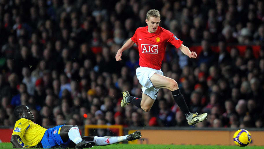 Manchester United's Scottish midfielder Darren Fletcher (R) jumps over a tackle from Stoke City's Senegalese midfielder Amdy Faye during the English Premiership football match at Old Trafford, Manchester, north-west England, on November 15, 2008.     AFP PHOTO/ANDREW YATES FOR EDITORIAL USE ONLY Additional licence required for any commercial/promotional use or use on TV or internet (except identical online version of newspaper) of Premier League/Football League photos. Tel DataCo +44 207 2981656. Do not alter/modify photo. (Photo credit should read ANDREW YATES/AFP/Getty Images)