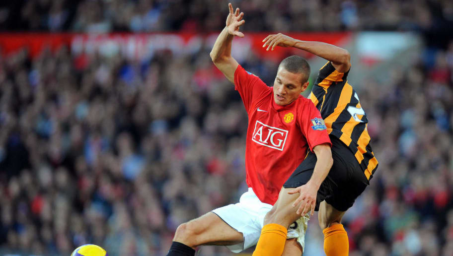 Manchester United's Serbian defender Nemanja Vidic (L) vies with Hull City's French-Gabonese forward Daniel Cousin during the English Premier league football match at Old Trafford, Manchester , north-west England, on November 1 2008. AFP PHOTO/ANDREW YATES  Mobile and website use of domestic English football pictures are subject to obtaining a Photographic End User Licence from Football DataCo Ltd Tel : +44 (0) 207 864 9121 or e-mail accreditations@football-dataco.com - applies to Premier and Football League matches. (Photo credit should read ANDREW YATES/AFP/Getty Images)