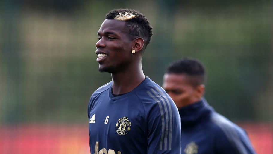 MANCHESTER, ENGLAND - OCTOBER 01:  Paul Pogba of Manchester United looks on during a training session ahead of their Group H match against Valencia in UEFA Champions League at Aon Training Complex on October 1, 2018 in Manchester, England.  (Photo by Clive Brunskill/Getty Images)