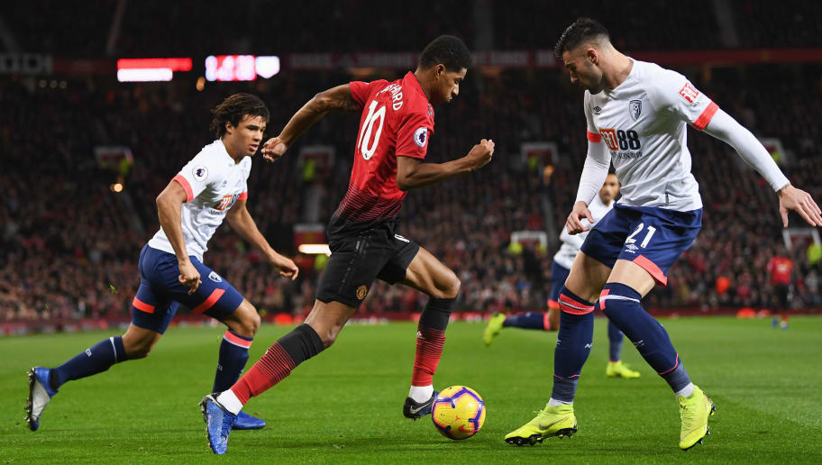 MANCHESTER, ENGLAND - DECEMBER 30:  Marcus Rashford of Manchester United evades Diego Rico of AFC Bournemouth (21) to create the first goal during the Premier League match between Manchester United and AFC Bournemouth at Old Trafford on December 30, 2018 in Manchester, United Kingdom.  (Photo by Michael Regan/Getty Images)