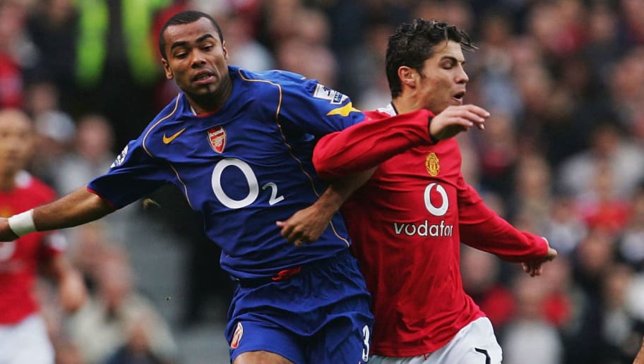 MANCHESTER, ENGLAND - OCTOBER 24: Cristiano Ronaldo of Manchester United battles with Ashley Cole of Arsenal during the FA Barclays Premiership match between Manchester United and Arsenal at Old Trafford on October 24, 2004 in Manchester, England. (Photo by Laurence Griffiths/Getty Images)
