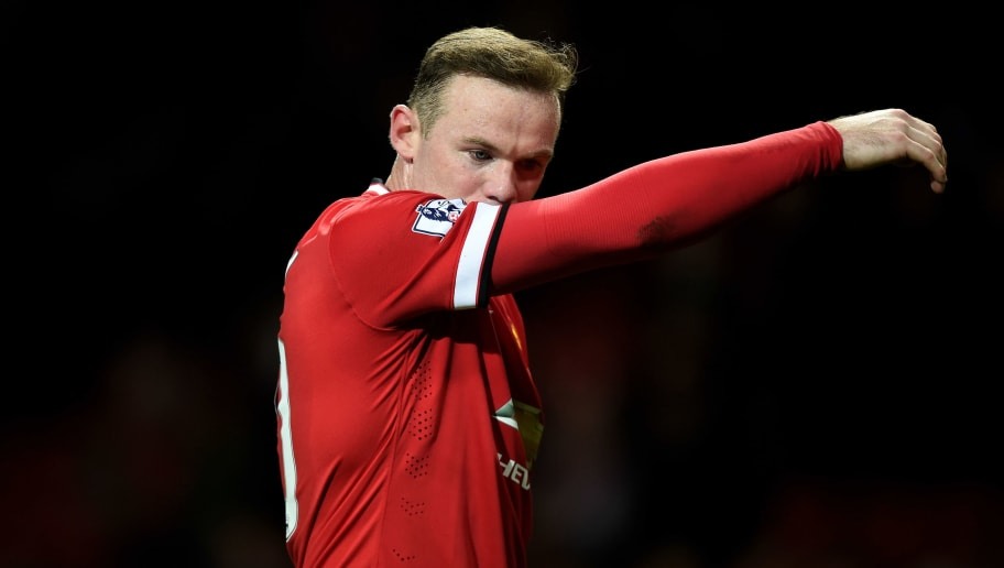 MANCHESTER, ENGLAND - MARCH 09:  A dejected Wayne Rooney of Manchester United walks off the pitch following his team's 2-1 defeat during the FA Cup Quarter Final match between Manchester United and Arsenal at Old Trafford on March 9, 2015 in Manchester, England.  (Photo by Michael Regan/Getty Images)