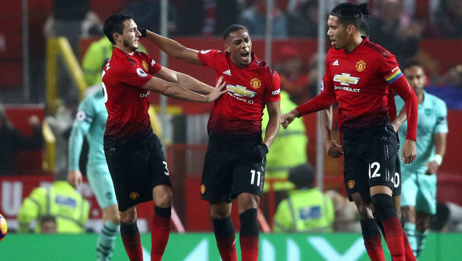 MANCHESTER, ENGLAND - DECEMBER 05:  Anthony Martial of Manchester United celebrates with teammates after scoring his team's first goal during the Premier League match between Manchester United and Arsenal FC at Old Trafford on December 5, 2018 in Manchester, United Kingdom.  (Photo by Clive Brunskill/Getty Images)
