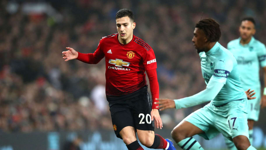 MANCHESTER, ENGLAND - DECEMBER 05:  Diogo Dalot of Manchester United battles for possession with Alex Iwobi of Arsenal during the Premier League match between Manchester United and Arsenal FC at Old Trafford on December 5, 2018 in Manchester, United Kingdom.  (Photo by Clive Brunskill/Getty Images)