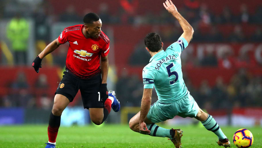 MANCHESTER, ENGLAND - DECEMBER 05: Anthony Martial of Manchester United battles for possession with Sokratis Papastathopoulos of Arsenal during the Premier League match between Manchester United and Arsenal FC at Old Trafford on December 5, 2018 in Manchester, United Kingdom.  (Photo by Clive Brunskill/Getty Images)