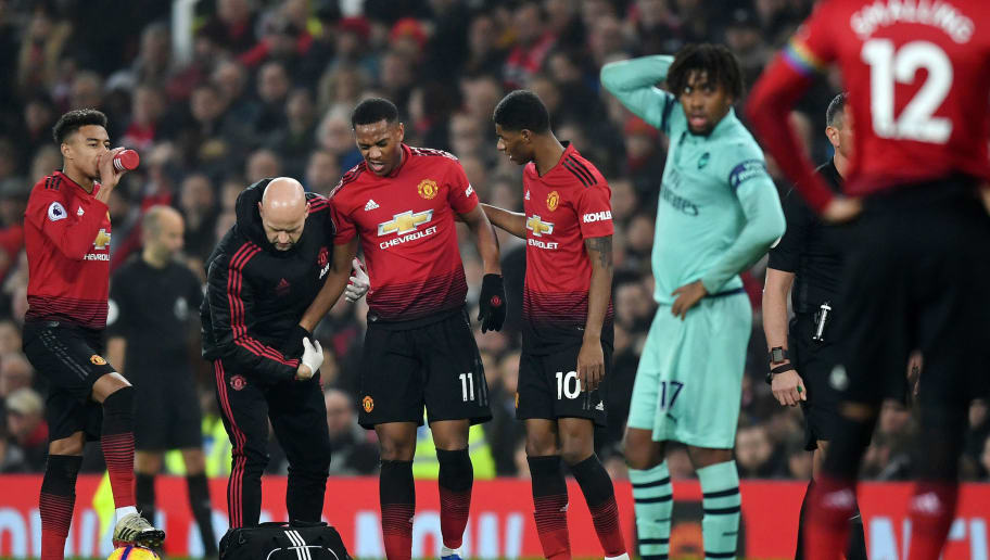 MANCHESTER, ENGLAND - DECEMBER 05:  Anthony Martial of Manchester United reacts to an injury during the Premier League match between Manchester United and Arsenal FC at Old Trafford on December 5, 2018 in Manchester, United Kingdom.  (Photo by Michael Regan/Getty Images)