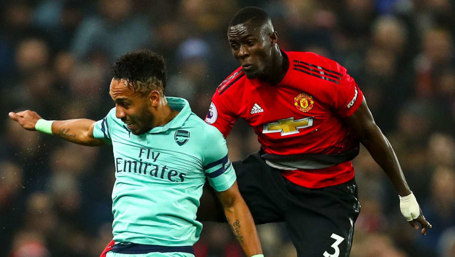 MANCHESTER, ENGLAND - DECEMBER 05: Pierre-Emerick Aubameyang of Arsenal and Eric Bailly of Manchester United during the Premier League match between Manchester United and Arsenal FC at Old Trafford on December 5, 2018 in Manchester, United Kingdom. (Photo by Robbie Jay Barratt - AMA/Getty Images)