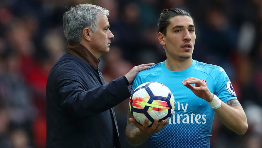 MANCHESTER, ENGLAND - APRIL 29: Jose Mourinho, Manager of Manchester United pats Hector Bellerin of Arsenal on the shoulder as he prepares to take a throw in during the Premier League match between Manchester United and Arsenal at Old Trafford on April 29, 2018 in Manchester, England.  (Photo by Clive Brunskill/Getty Images)