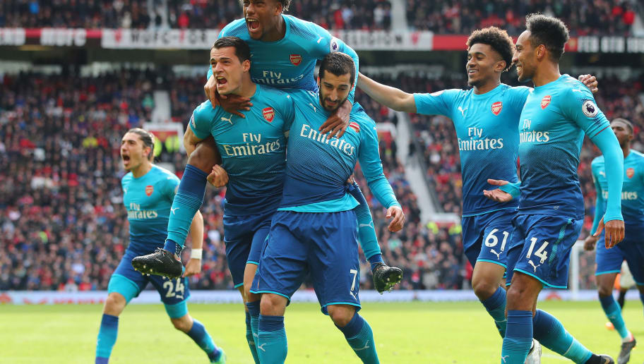MANCHESTER, ENGLAND - APRIL 29: Henrikh Mkhitaryan of Arsenal celebrates after scoring his sides first goal with Granit Xhaka of Arsenal, Alex Iwobi of Arsenal, Reiss Nelson of Arsenal and Pierre-Emerick Aubameyang of Arsenal during the Premier League match between Manchester United and Arsenal at Old Trafford on April 29, 2018 in Manchester, England.  (Photo by Clive Brunskill/Getty Images)