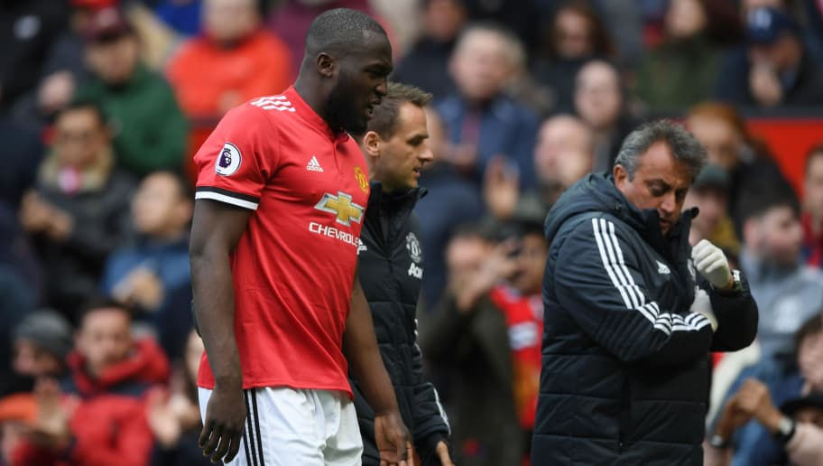 MANCHESTER, ENGLAND - APRIL 29: Romelu Lukaku of Manchester United is taken off injured during the Premier League match between Manchester United and Arsenal at Old Trafford on April 29, 2018 in Manchester, England.  (Photo by Shaun Botterill/Getty Images)