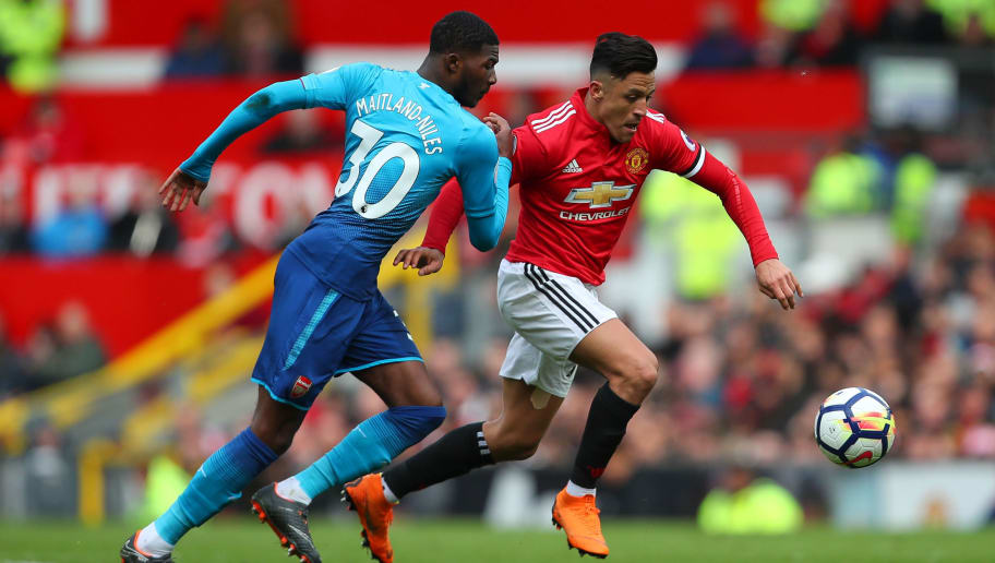 MANCHESTER, ENGLAND - APRIL 29: Ainsley Maitland-Niles of Arsenal and Alexis Sanchez of Manchester United during the Premier League match between Manchester United and Arsenal at Old Trafford on April 29, 2018 in Manchester, England. (Photo by Robbie Jay Barratt - AMA/Getty Images)