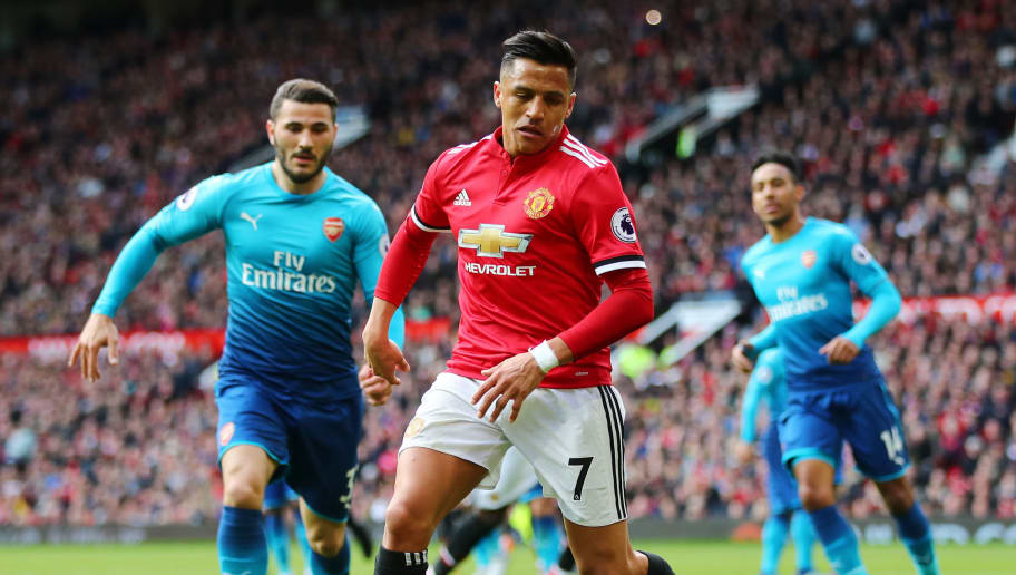 MANCHESTER, ENGLAND - APRIL 29: Alexis Sanchez of Manchester United runs with the ball during the Premier League match between Manchester United and Arsenal at Old Trafford on April 29, 2018 in Manchester, England.  (Photo by Clive Brunskill/Getty Images)