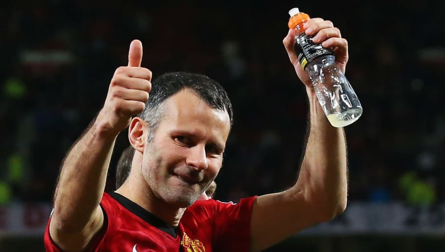 MANCHESTER, ENGLAND - APRIL 22: Ryan Giggs of Manchester United celebrates victory and winning the Premier League title after the Barclays Premier League match between Manchester United and Aston Villa at Old Trafford on April 22, 2013 in Manchester, England.  (Photo by Alex Livesey/Getty Images)