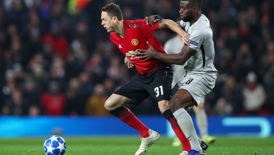 MANCHESTER, ENGLAND - NOVEMBER 27:  Nemanja Matic of Manchester United holds off Jean-Pierre Nsame of Young Boys during the UEFA Champions League Group H match between Manchester United and BSC Young Boys at Old Trafford on November 27, 2018 in Manchester, United Kingdom.  (Photo by Clive Brunskill/Getty Images)
