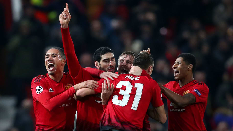MANCHESTER, ENGLAND - NOVEMBER 27:  Marouane Fellaini of Manchester United celebrates with team mates Marcus Rashford, Nemanja Matic, Luke Shaw and Chris Smalling after scoring their team's first goal during the Group H match of the UEFA Champions League between Manchester United and BSC Young Boys at Old Trafford on November 27, 2018 in Manchester, United Kingdom. (Photo by Clive Brunskill/Getty Images)