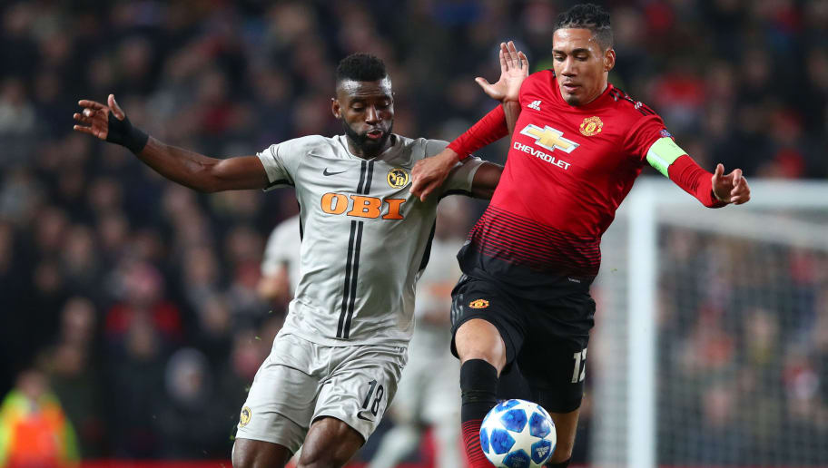 MANCHESTER, ENGLAND - NOVEMBER 27:  Chris Smalling of Manchester United tussles with Jean-Pierre Nsame of Young Boys during the UEFA Champions League Group H match between Manchester United and BSC Young Boys at Old Trafford on November 27, 2018 in Manchester, United Kingdom.  (Photo by Clive Brunskill/Getty Images)