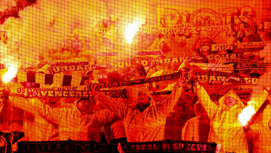 MANCHESTER, ENGLAND - NOVEMBER 27: A general view of fans of BSC Young Boys as they hold up flares and scarves during the Group H match of the UEFA Champions League between Manchester United and BSC Young Boys at Old Trafford on November 27, 2018 in Manchester, United Kingdom. (Photo by Robbie Jay Barratt - AMA/Getty Images)