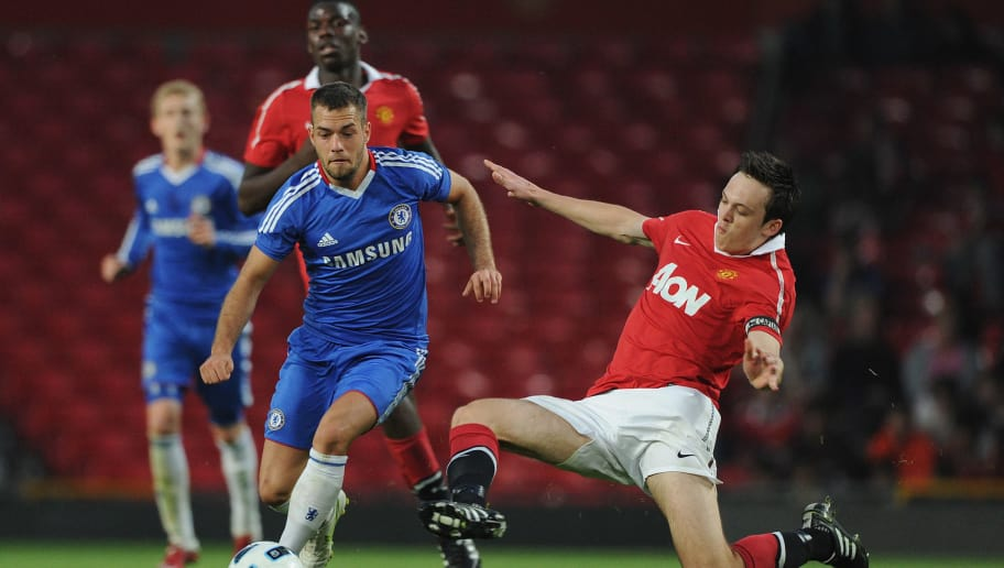 MANCHESTER, ENGLAND - APRIL 20: Milan Lalkovic of Chelsea is tackled by Tom Thorpe of Manchester United during the FA Youth Cup Semi Final 2nd Leg between Manchester United and Chelsea at Old Trafford on April 20, 2011 in Manchester, England. (Photo by Michael Regan/Getty Images)