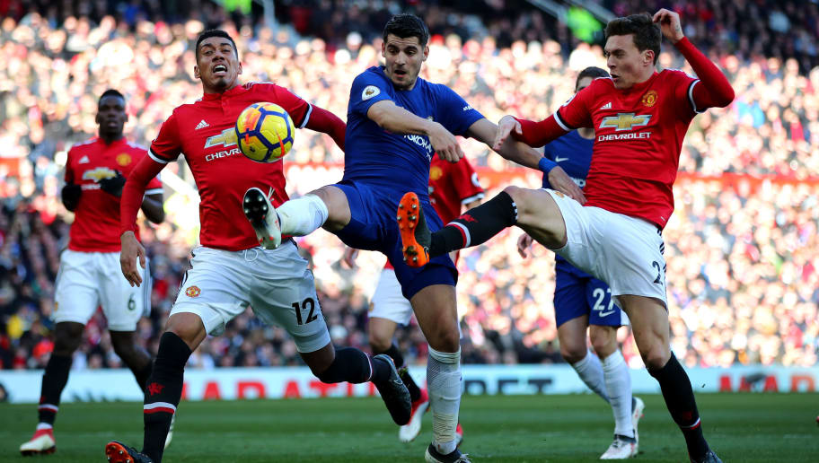 MANCHESTER, ENGLAND - FEBRUARY 25:  Alvaro Morata of Chelsea, Victor Lindelof and Chris Smalling of Manchester United compete for the ball during the Premier League match between Manchester United and Chelsea at Old Trafford on February 25, 2018 in Manchester, England.  (Photo by Clive Brunskill/Getty Images)