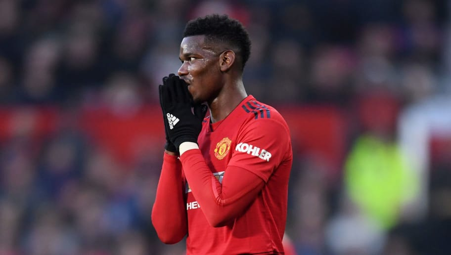 MANCHESTER, ENGLAND - NOVEMBER 24:  Paul Pogba of Manchester United reacts during the Premier League match between Manchester United and Crystal Palace at Old Trafford on November 24, 2018 in Manchester, United Kingdom.  (Photo by Laurence Griffiths/Getty Images)
