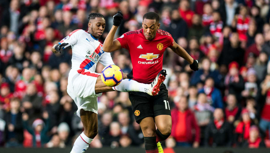 MANCHESTER, ENGLAND - NOVEMBER 24: Anthony Martial of Manchester United and Aaron Wan-Bissaka of  Crystal Palace during the Premier League match between Manchester United and Crystal Palace at Old Trafford on November 24, 2018 in Manchester, United Kingdom. (Photo by Sebastian Frej/MB Media/Getty Images)