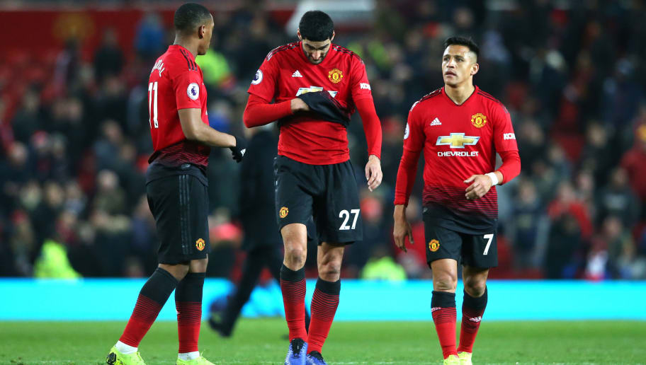 MANCHESTER, ENGLAND - NOVEMBER 24:  Alexis Sanchez, Anthony Martial and Marouane Fellaini of Manchester United look dejected following the Premier League match between Manchester United and Crystal Palace at Old Trafford on November 24, 2018 in Manchester, United Kingdom.  (Photo by Alex Livesey/Getty Images)