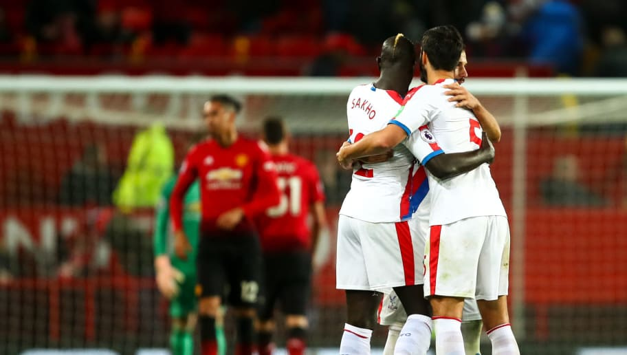 MANCHESTER, ENGLAND - NOVEMBER 24: Players of Crystal Palace celebrate at full time during the Premier League match between Manchester United and Crystal Palace at Old Trafford on November 24, 2018 in Manchester, United Kingdom. (Photo by Robbie Jay Barratt - AMA/Getty Images)